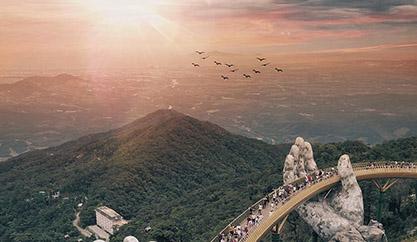 A giant pair of hands lift up DaNang's Golden Bridge into the sky