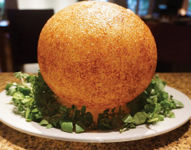 The dough is used to make thin circle which is deep-fried in a pan until it becomes a crispy ball. Photo: Collection